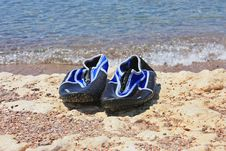 Free Swimming Shoes On Stone Royalty Free Stock Photos - 18336158