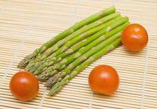 Free Asparagus And Tamatos On Bamboo Substrate Stock Photo - 18336810