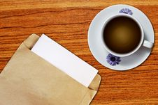 Free White Cup Of Coffee And Brown Envelope Royalty Free Stock Photo - 18337205