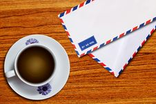 Free Air Mail Envelope And Coffee Cup Royalty Free Stock Image - 18337206