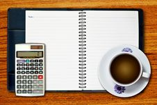 Free White Cup Of Coffee And Calculator Stock Photography - 18337362