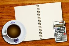 Free White Cup Of Coffee And Calculator Stock Photo - 18337440