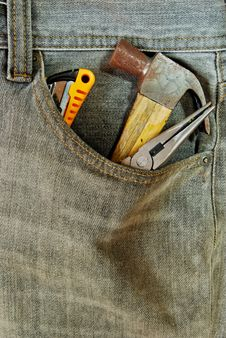 Repairman Jean With Tool In Pocket Royalty Free Stock Photography