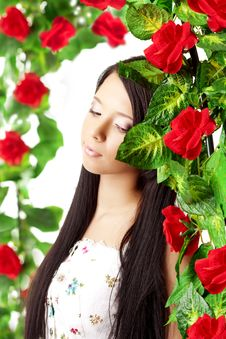 Free Beautiful Girl With Bright Make-up Among The Roses Stock Images - 18338424