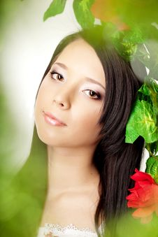 Free Beautiful Girl With Bright Make-up Among The Roses Royalty Free Stock Images - 18338449