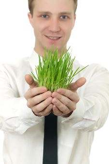 Free Man Holding A Small Plant Stock Image - 18341441