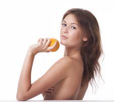 The Woman With An Orange Fruit Stock Photos