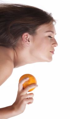 Free The Woman With An Orange Fruit Royalty Free Stock Image - 18342216