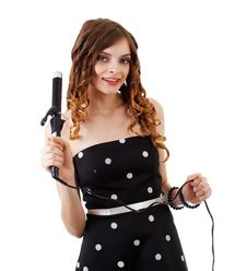 Beautiful Girl Doing Hairstyle With Hair Iron Royalty Free Stock Photos