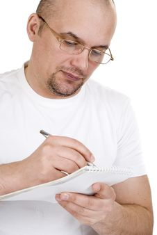 Free The Man Writes In A Notebook Royalty Free Stock Photo - 18346365