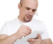 Free The Man Writes In A Notebook Royalty Free Stock Photo - 18346595