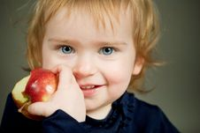 Girl Eats An Apple Stock Photo