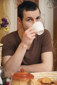 Free Young Guy With Tea And Rusk In The Kitchen Stock Image - 18350361