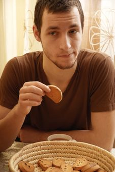 Free Young Guy With Tea And Rusk In The Kitchen Stock Images - 18350664