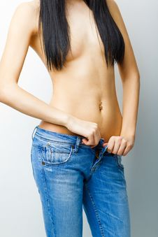 Sexy, Fit Woman In Jeans Royalty Free Stock Image