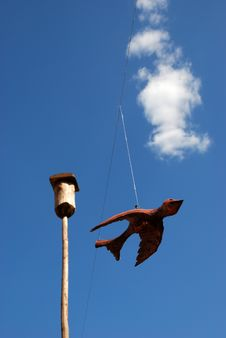 Wooden Bird On Blue Sky Stock Photos