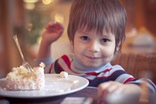 Young Boy In Cafe Stock Photo