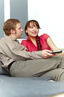 Free Nice Couple Watching Tv On The Sofa Stock Images - 18353284