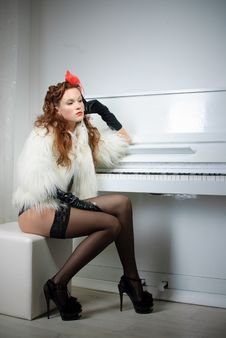 Free Sexy Woman Near White Piano Stock Photos - 18354343