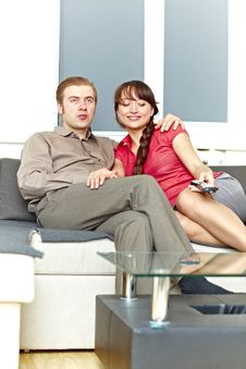 Nice Couple Watching Tv At Home Stock Images