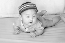 Free Baby Laying On Bed With Cute Expression Stock Image - 18356491