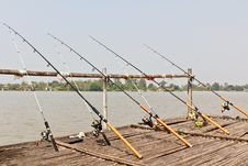 Free Fishing Poles On Pier Stock Photos - 18358183