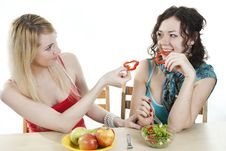 Free Girlfriends Cheerfully Feed Each Other Stock Photos - 18358623