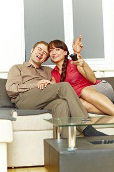Nice Couple Watching Tv Stock Image