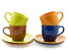 Four  Cups  With Saucers Of Differenr Colours Stock Photography