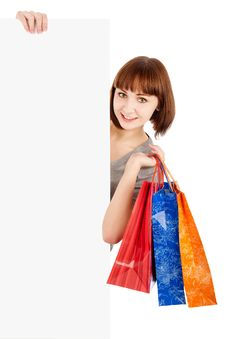 Free Woman With Shopping Bags Holding Blank Billboard Stock Image - 18359671