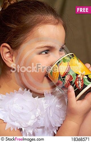 Girl drinks. Stock Photo