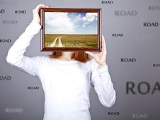 Free Girl Keep Frame With Village Road Inside. Stock Photos - 18360753