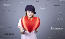 Beautiful Red-haired Girl In Cap With Toy Heart. Stock Photography