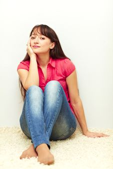 Free Nice Young Female Sitting Relaxed By The Wall Stock Image - 18361681