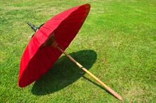 Free Red Umbrella On The Lawn Stock Photography - 18366782