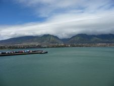 Clouds Over Mountains At Dockyard Royalty Free Stock Images