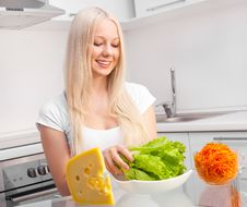 Free Woman In The Kitchen Stock Image - 18368121