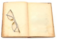 Opened Old Book With Eyeglass Stock Photo