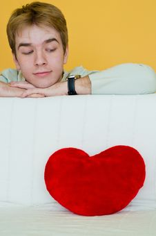 Young Man And A Red Heart Royalty Free Stock Photo