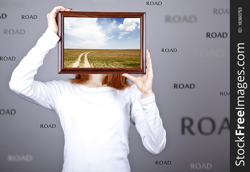 Girl keep frame with village road inside.
