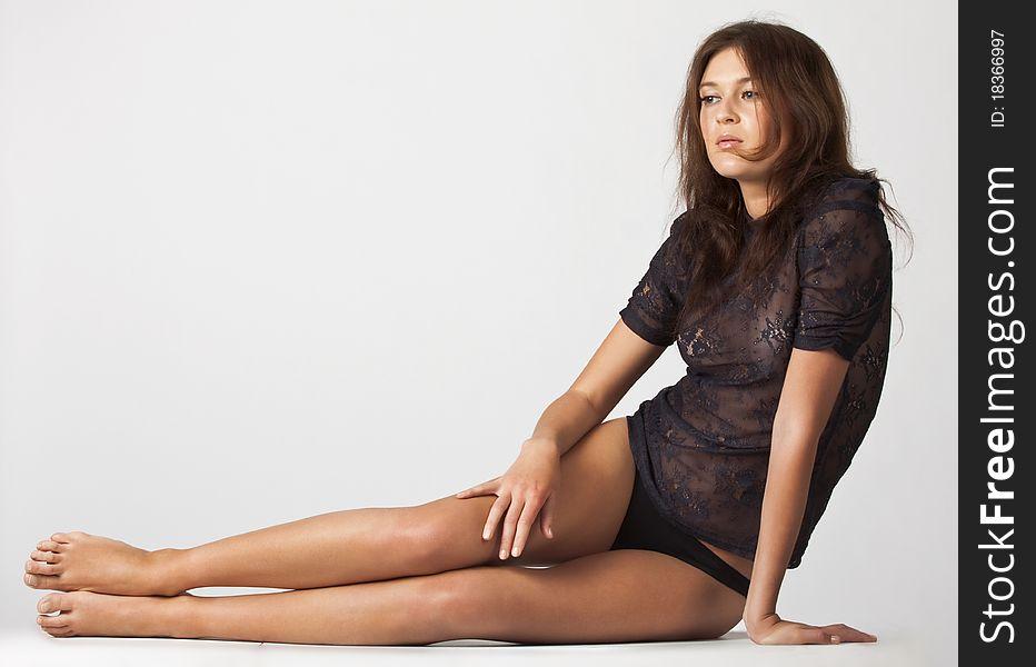 Adult beautiful sensual brunette sitting