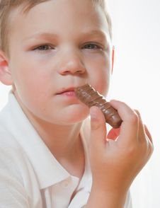 Free Boy With Chocolate Bar Royalty Free Stock Photos - 18371978