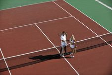 Free Happy Young Couple Play Tennis Game Outdoor Stock Image - 18373511