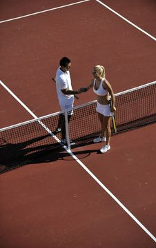 Free Happy Young Couple Play Tennis Game Outdoor Royalty Free Stock Photos - 18373788