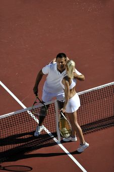 Free Happy Young Couple Play Tennis Game Outdoor Royalty Free Stock Image - 18373916