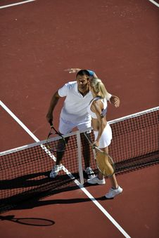 Free Happy Young Couple Play Tennis Game Outdoor Stock Photography - 18373962