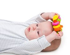 The Kid, Holds A Toy Two Hands Stock Photo