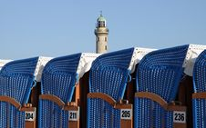 Free Canopied Beach Chairs With Light Tower Stock Images - 18377374