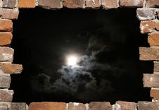 Old Brick Wall As A Frame By Night Stock Photo