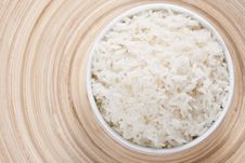 Rice In A Bowl On A Bamboo Plate Stock Photo